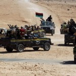 Anti-Gaddafi fighters drive towards Sirte, the hometown of deposed leader Muammar Gaddafi